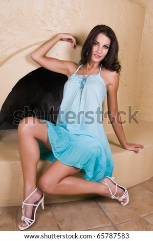 Beautiful young Czech woman in a turquoise dress
