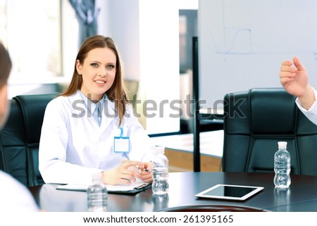 Beautiful young doctor in conference room