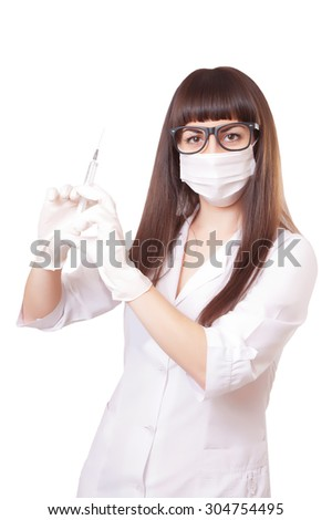 Beautiful young doctor in medical robe holding syringe, isolated on white - stock photo
