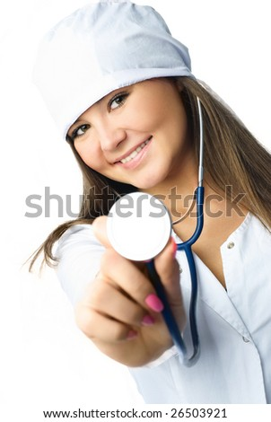 beautiful young doctor wearing white uniform using a stethoscope for a patient examination (focus on the face) - stock photo