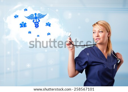 Beautiful young doctor with abstract cloud and medical icons