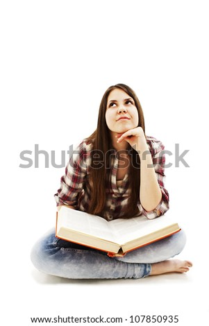 Beautiful young dreaming woman looking up while reading a book.  Isolated on a white background. - stock photo