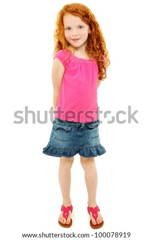 Beautiful young elementary age school girl over white with long curly red hair in summer clothes. - stock photo