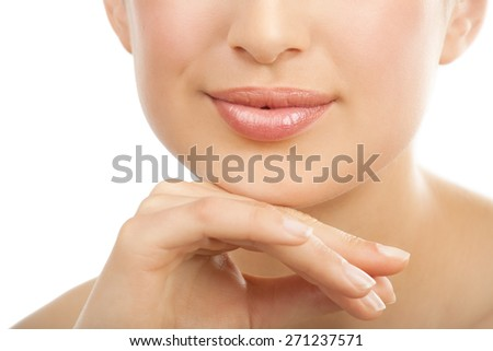 Beautiful young European woman with fresh smooth glowing skin and perfect full lips. - stock photo