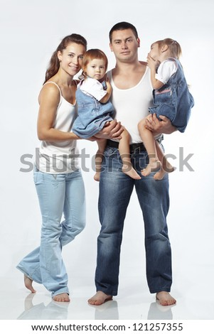 Beautiful young family happy with their kids - stock photo