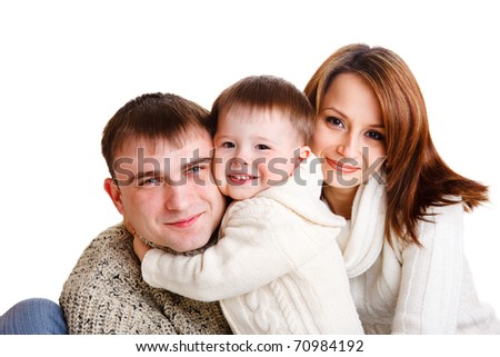 Beautiful young family of three, isolated - stock photo