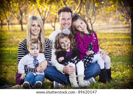 Beautiful Young Family Portrait outdoors - stock photo