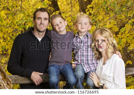 Beautiful Young Family Portrait with Fall colors - stock photo