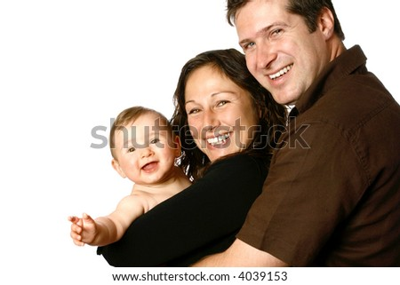Beautiful young family, side view with mother holding laughing baby. - stock photo