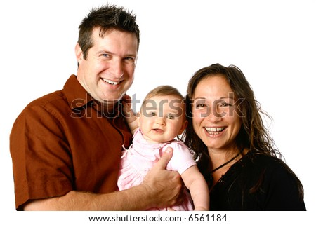 Beautiful young family with bouncing baby girl - stock photo
