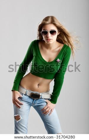 Beautiful young fashion model isolated on white background - stock photo