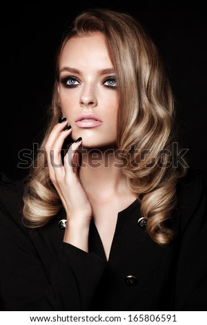 Beautiful young fashion model with make up and manicure - stock photo
