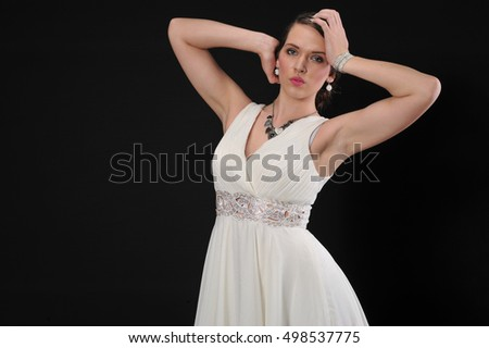 beautiful young fashion women posing in studio with white dress