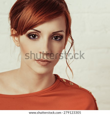 Beautiful young fashionable woman posing in red dress. Looking at camera. Vogue style. Photo with instagram style filters - stock photo