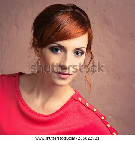 Beautiful young fashionable woman posing in red dress, smiling, looking at camera. Vogue Style. Photo with instagram style filters - stock photo