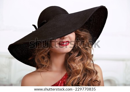 Beautiful young fashionable woman with red lips posing in black hat. Vogue style. Fashion Photo - stock photo