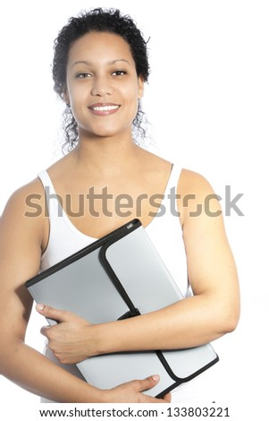 Beautiful young female African American graduate student or business woman holding a stylish folder in her arms as she smiles at the camera isolated on white