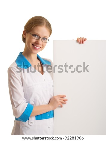 beautiful young female doctor holding a blank billboard isolated on white background