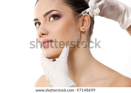 beautiful young female face and hands in gloves with beauty treatment injection isolated on white - stock photo