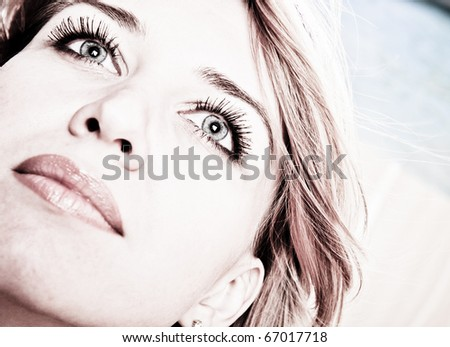 Beautiful young female face with a wellness complexion retro feeling style - stock photo