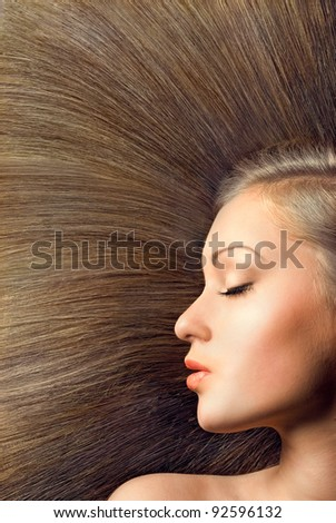 beautiful young female face with long beauty hair as background