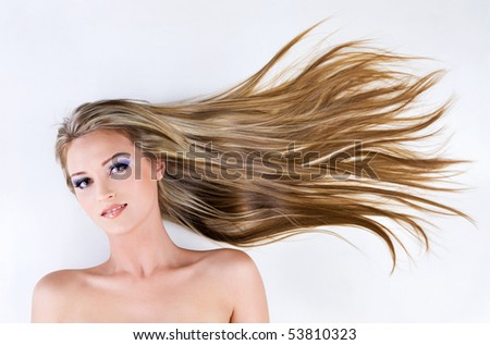 beautiful young female face with long blond straight hair as background - stock photo