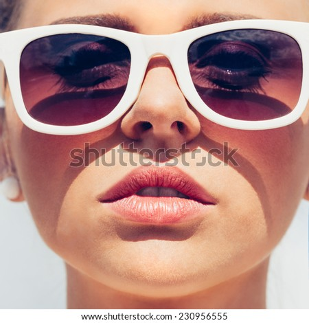 Beautiful young female face with sunglasses - close-up outdoor lifestyle - stock photo