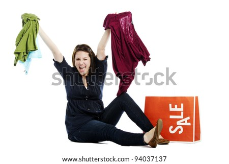Beautiful young female holding up clothes with sale on bag