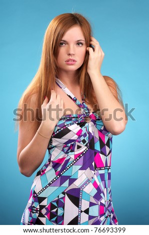 Beautiful young female over blue background - stock photo