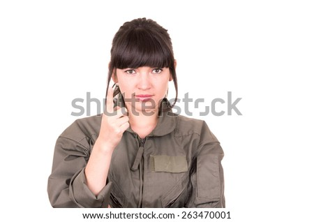 beautiful young female pilot wearing uniform holding one finger up isolated on white
