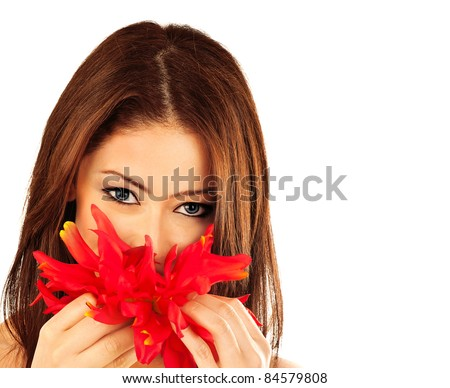 Beautiful young female portrait, hand holding a red flower, isolated on white background wit text white space, beauty concept - stock photo