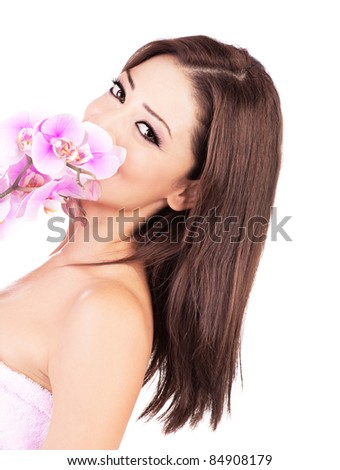 Beautiful young female portrait, smelling purple orchid, isolated on white background with white text space, beauty and spa concept - stock photo
