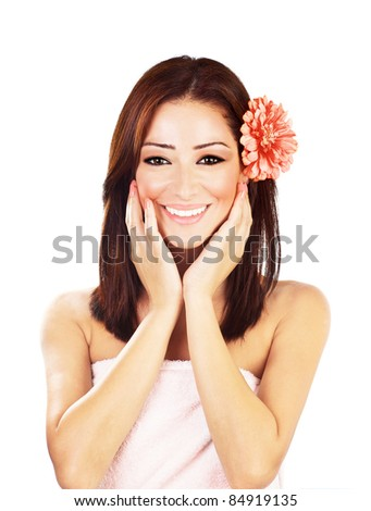 Beautiful young female portrait with flower in hair, hands touching clean face, isolated on white background with white text space, beauty and spa concept - stock photo