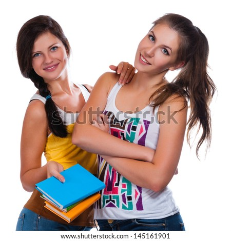 beautiful young female students on a white background - stock photo