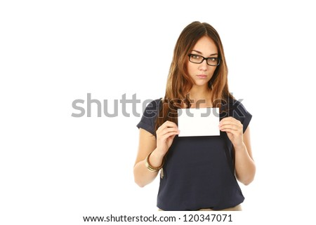 beautiful young female teacher holding blank note card isolated on white