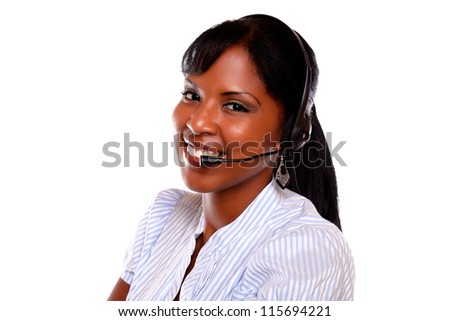 Beautiful young female using headphones against white background - stock photo