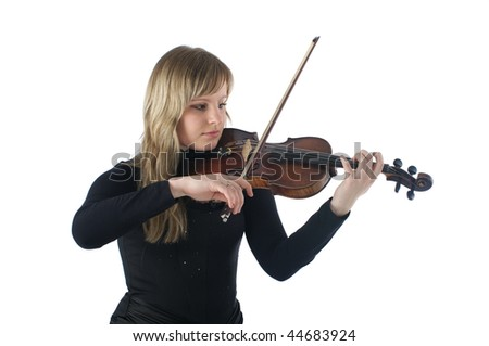 Beautiful young female violinist playing violin over white background - stock photo