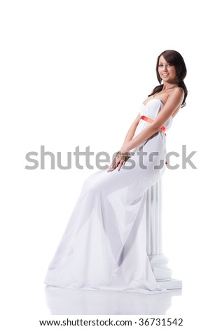 Beautiful young female wearing white dress in antique style isolated on white - stock photo