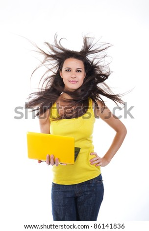 beautiful young female with a laptop - stock photo