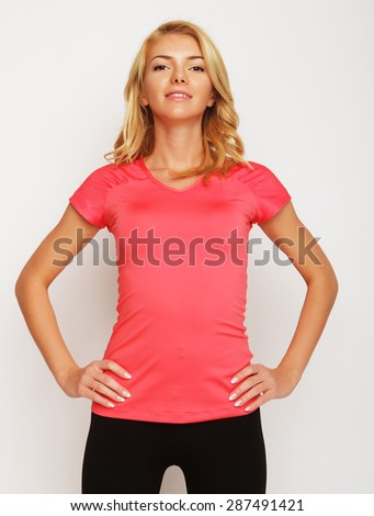 Beautiful young fitness trainer standing isolated over white background - stock photo