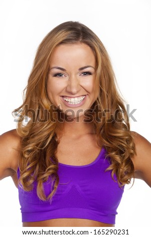Beautiful young fitness woman. Isolated over white background - stock photo
