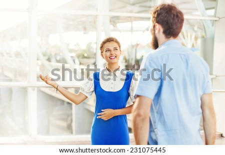 Beautiful young flight attendant in the airport - stock photo