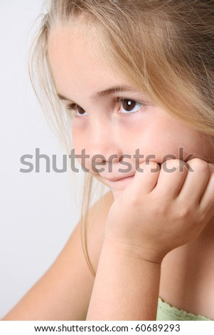Beautiful young girl against a light background