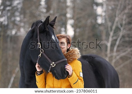 Beautiful young girl and a horse. - stock photo
