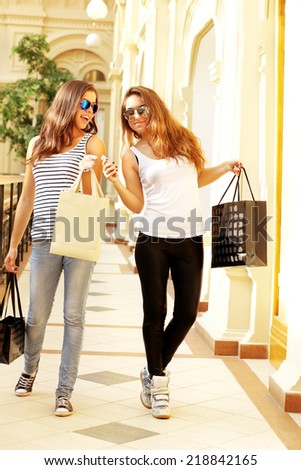 Beautiful young girl  at the shopping mall - stock photo