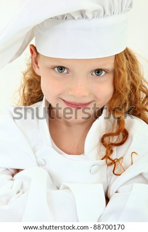 Beautiful young girl child wearing chef uniform and baker hat over white. Arms crossed, smiling. - stock photo