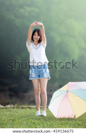 Beautiful young girl doing exercises outdoor. Beautiful young girl warm up outdoor in morning during sunrise