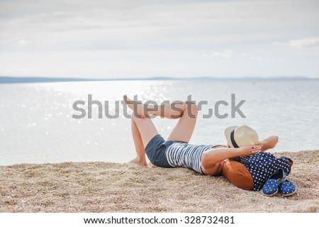 Beautiful young girl enjoying freedom at the beach  - stock photo