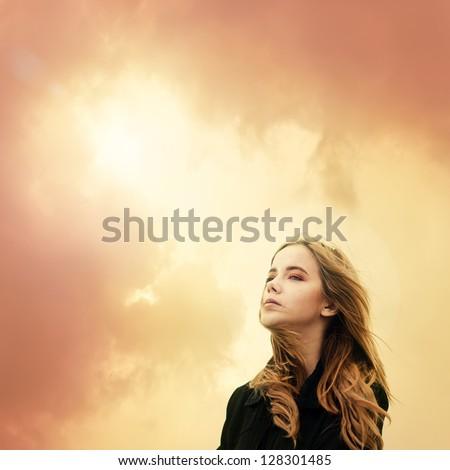 beautiful young girl enjoying the sunny freshness - stock photo
