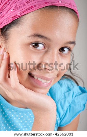Beautiful young girl from an Asian and European background - stock photo